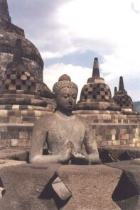 Buddha statue and stupas at Borobudur, courtesy: http://perso.club-internet.fr/pchanez/index_eng.html